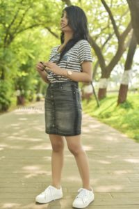 black denim skirt with a stripes tee and white platform sneakers